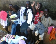 ABA Destitute Kids happy with gifts of clothings
