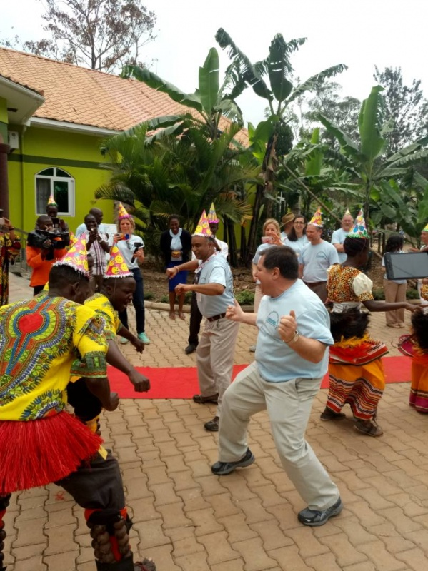 Visiting volunteers get entertained with a colourful traditional dance